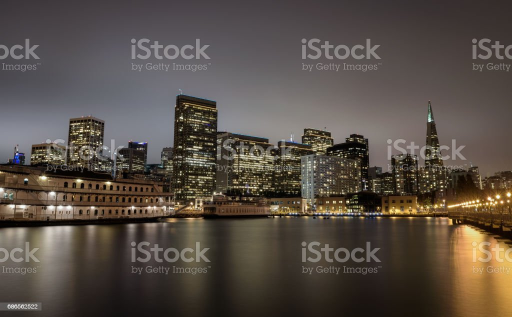 San Francisco skyline from Pier 7 after sunset stock photo