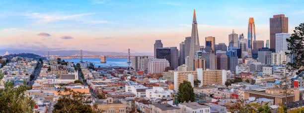 San Francisco skyline panorama at sunset with Bay Bridge and downtown skyline stock photo