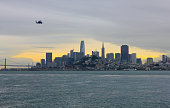 San Francisco Skyline Panorama during Sunset, with a Helicopter in the foreground