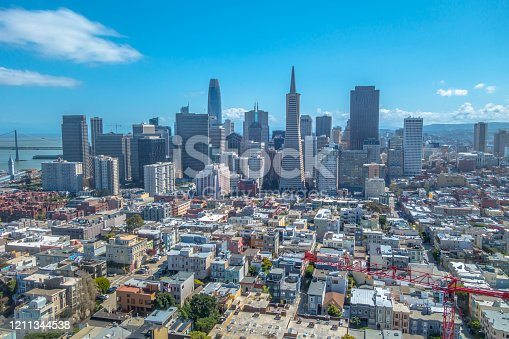 San Francisco skyline with crane in foreground and blue sky, California, USA. Royalty free stock photo.