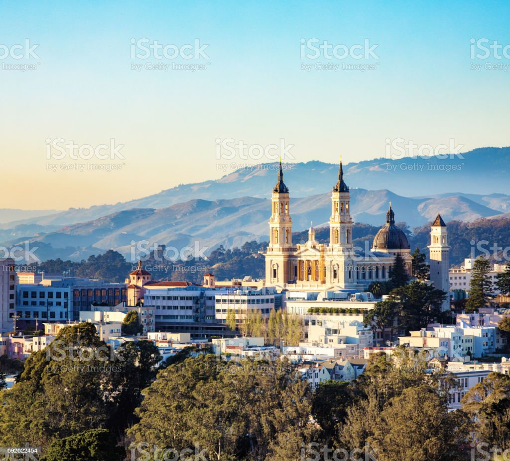 San Francisco St. Ignatius Church at sunset elevated view with hills stock photo