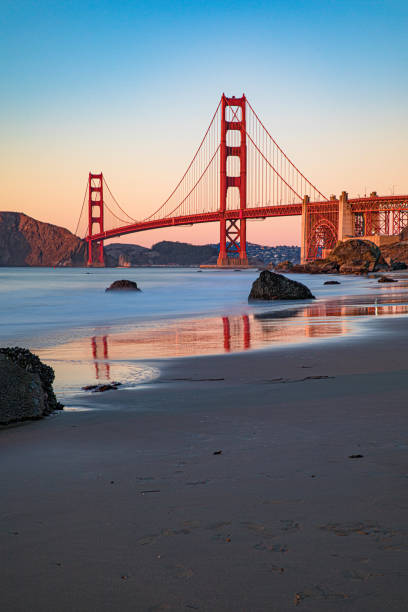 San Francisco - The Golden Gate Bridge at sunset from the beach stock photo