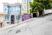 Classic urban scene of historic colorful buildings along one of San Francisco's steepest streets near Telegraph Hill residential area district on a beautiful sunny day in summer, SF, California, USA