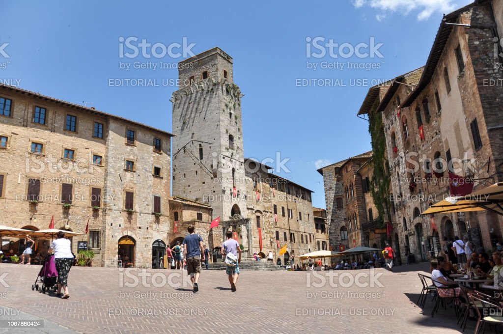 Town square in San Gimignano - a small walled medieval hill town in...