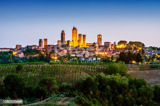 panoramic view of San Gimignano town at dusk. Tuscany. Italy
