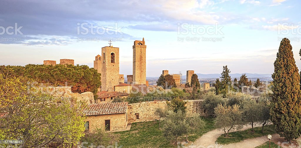 San Gimignano landmark on sunset, towers and park. Tuscany, Italy stock photo