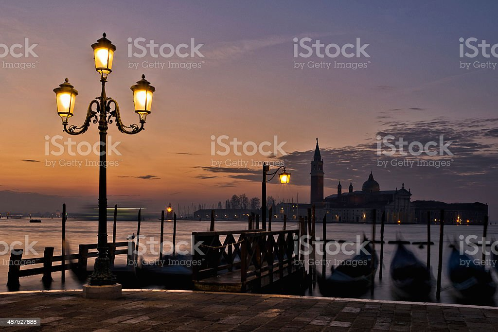 San Giorgio Maggiore at sunrise across the Lagoon stock photo