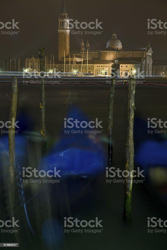 San Giorgio Maggiore with mooving gondola at night stock photo