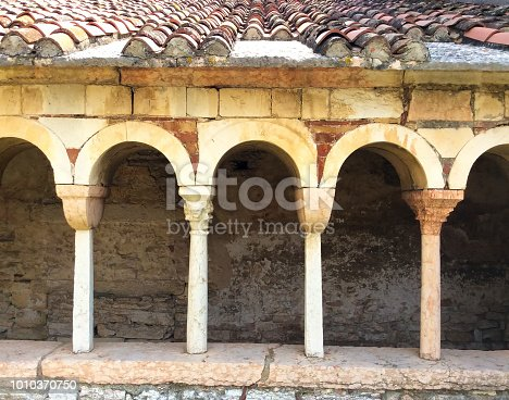 San Giorgio Valpolicella, Italy: Arches in the 7th century Romanesque cloister (close-up) in the hill town of San Giorgio Valpolicella in Verona Province.