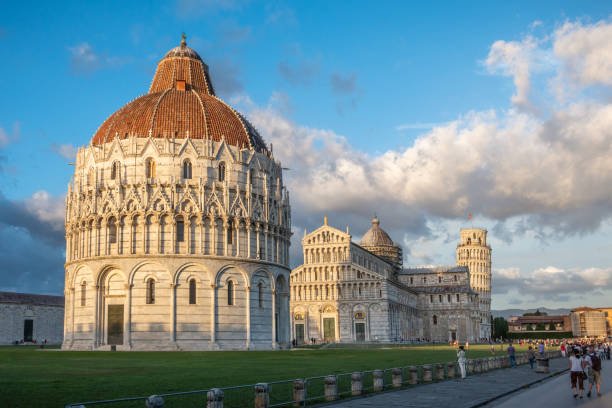 San Giovanni Baptistery, Pisa Cathedral and Leaning Tower of Pisa at sunrise. Pisa ,Tuscany region, Italy stock photo