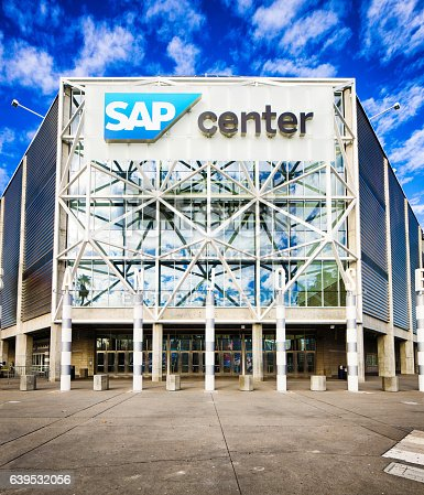 San Jose, USA - December 21, 2016: San Jose SAP center arena concert hall main entrance with sidewalk and sky. Some construction and a woman can be seen at the bottom left.