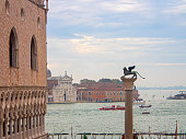 San Marco Columns with winged lion in Piazza San Marco , Venice,Italy. In the background is a water bus or Veneto.