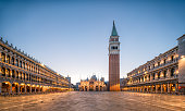 Wide view of Venice in Italy during the high tide in Winter with bell tower of Saint Mark in the main square