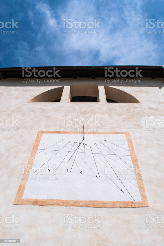 San Martino: the sundial on the parish church of San Martino, Saint Martin, the village starting point for the hiking in the Val di Mello (Mello Valley) stock photo