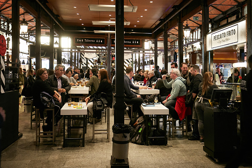 Madrid, Spain - February 14, 2020: People eating in the famous and tourist Mercado de San Miguel in the centre of Madrid, Spain
