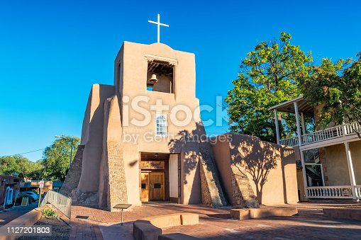 Stock photograph of the historic, early 17th century San Miguel Mission in downtown Santa Fe, New Mexico USA on a sunny day.