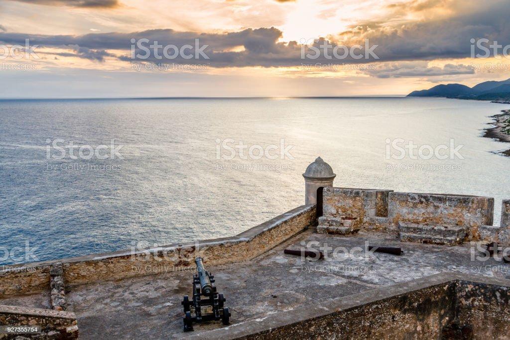 San Pedro de La Roca fort walls with canon, Caribbean sea sunset view, Santiago De Cuba, Cuba