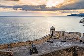 istock San Pedro de La Roca fort walls with canon, Caribbean sea sunset view, Santiago De Cuba, Cuba 927355754