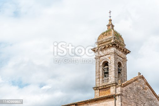 istock San Quirico D'Orcia, Italy small historic medieval town village in Tuscany and famous church bell tower closeup isolated against sky 1140999857
