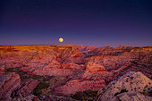 Moon rising over the San Rafael Swell also known as the little grand canyon