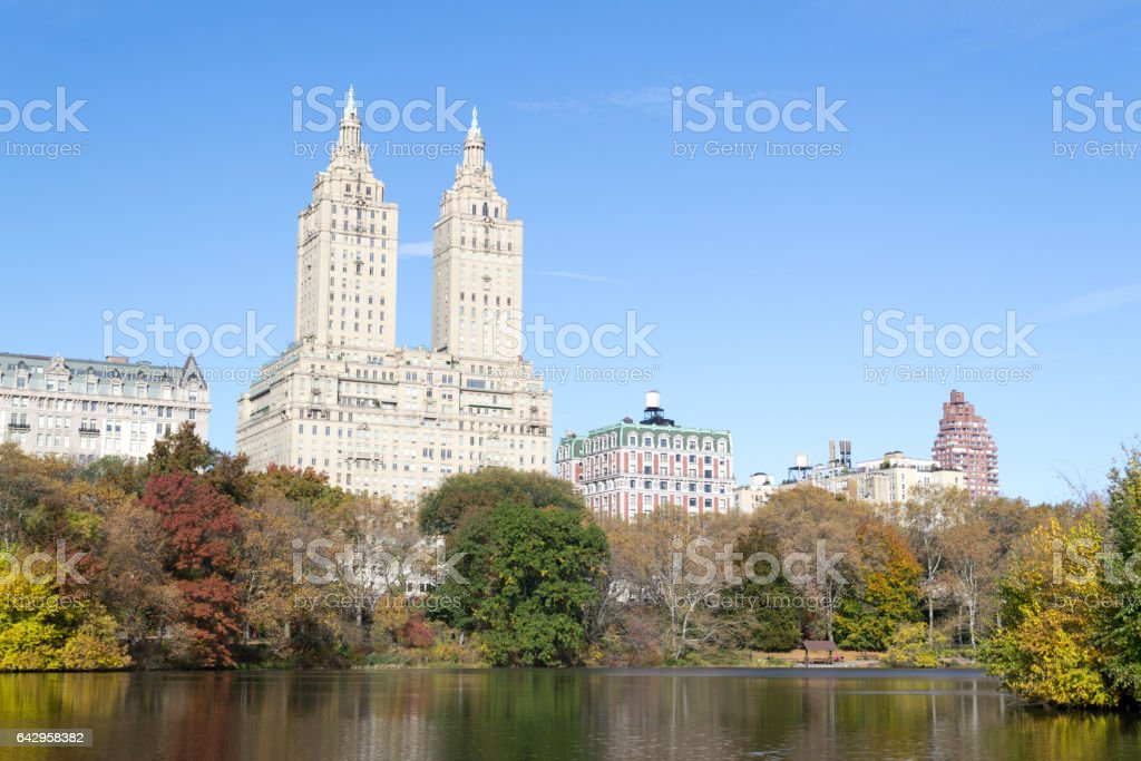 San Remo and Dakota buildings from Central Park during the fall season stock photo