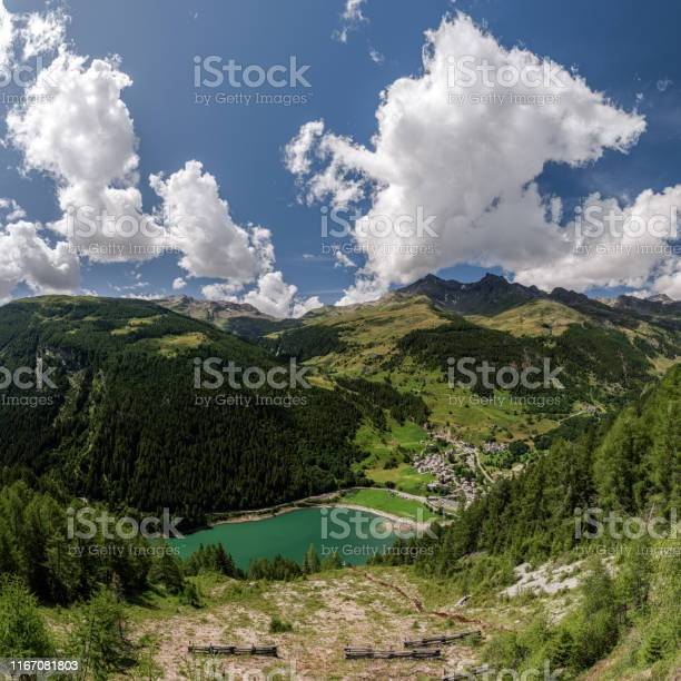 San Rocco, Madesimo, Sondrio, August 8, 2019 - Panoramic view on lake of Isola, taken from SS36 Lake Como and Spluga State Road. Panorama obtained by merging together 12 photos. - Стоковые фото Без людей роялти-фри
