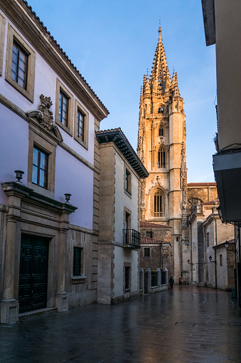 Oviedo, Spain - December 29, 2019: San Salvador cathedral of Oviedo in Alfonso II el Casto Square at sunrise.