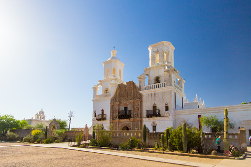 Tucson, Arizona, USA - May 3, 2019: Exterior of the San Xavier Mission in Tucson. The mission is the oldest remaining European structure in Arizona. The Franciscan Catholic Mission was completed in 1791 and remains open for worship and services today.