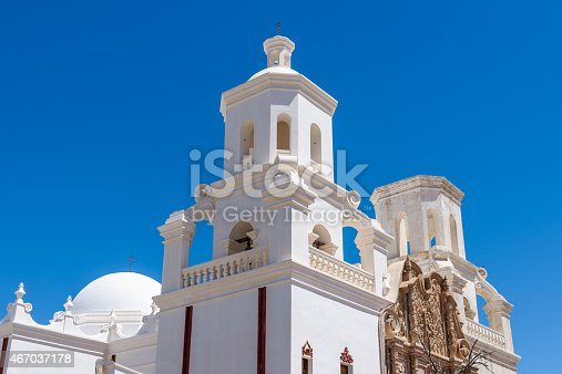 San Xavier del Bac Mission, White Mission Church Building, Tucson, Arizona. Archtecture close-up, Clear blue sky