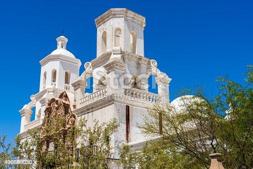 San Xavier del Bac Mission, White Mission Church Building, Tucson, Arizona, desert vegetation. Clear blue sky