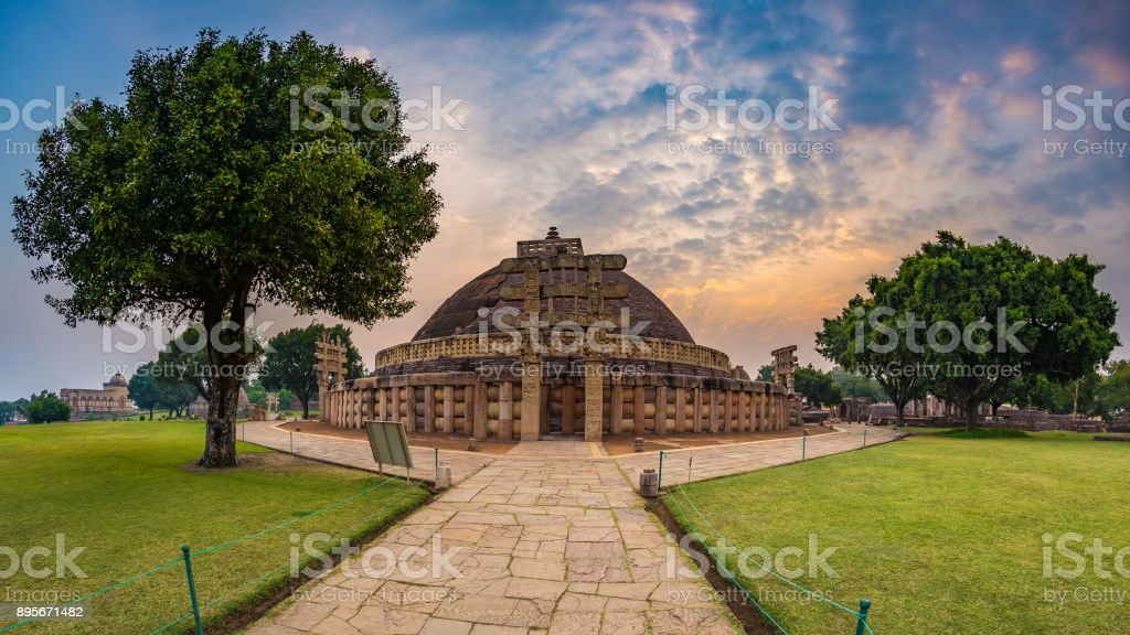 Sanchi Stupa, Madhya Pradesh, India. Ancient buddhist building, religion mystery, carved stone. Sunrise sky. stock photo