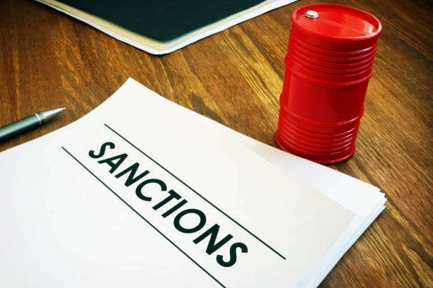 Sanctions list with model of oil barrel. Sanctions list with model of oil barrel. sanctions stock pictures, royalty-free photos & images