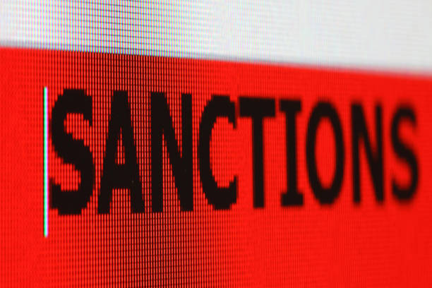 Sanctions Sanctions - text on computer monitor. sanctions stock pictures, royalty-free photos & images