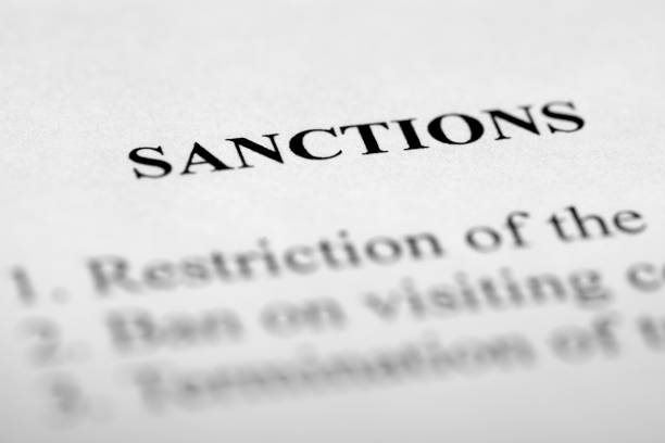 Sanctions Sanctions - text on paper. sanctions stock pictures, royalty-free photos & images