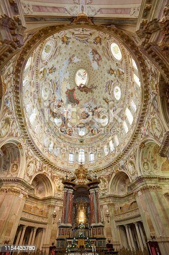 Vicoforte, Italy - August 17, 2016: Sanctuary of Vicoforte elliptical baroque dome with frescos and Holy Mary ancient painting in Piedmont, Italy