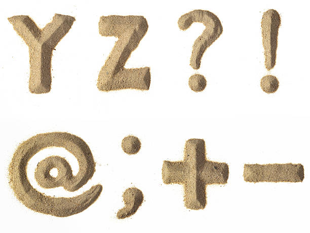 sand alphabet xxxl - komma stock-fotos und bilder