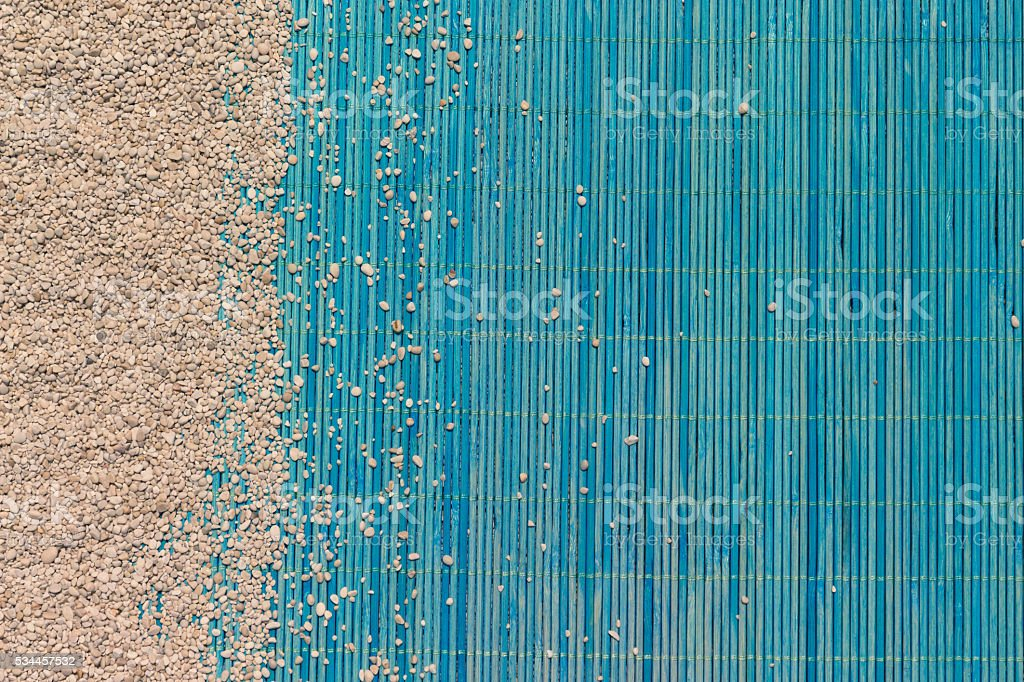 Sand and bamboo mat texture background stock photo
