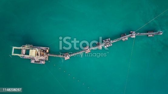 Sand and gravel pit, large dredger  - aerial view