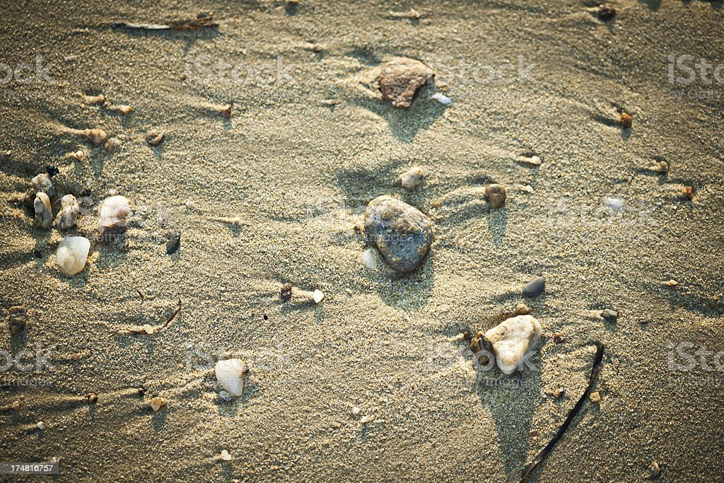 sand and litlle rocks on the beach royalty-free stock photo