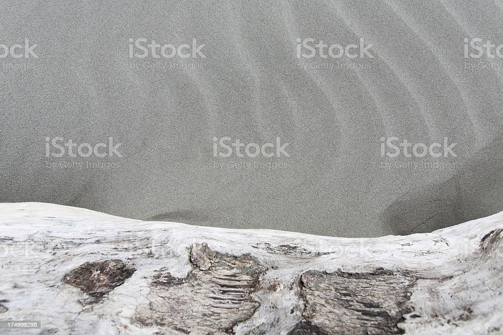 Sand and log royalty-free stock photo