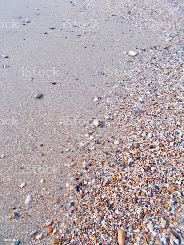 Sand and pebbles stock photo
