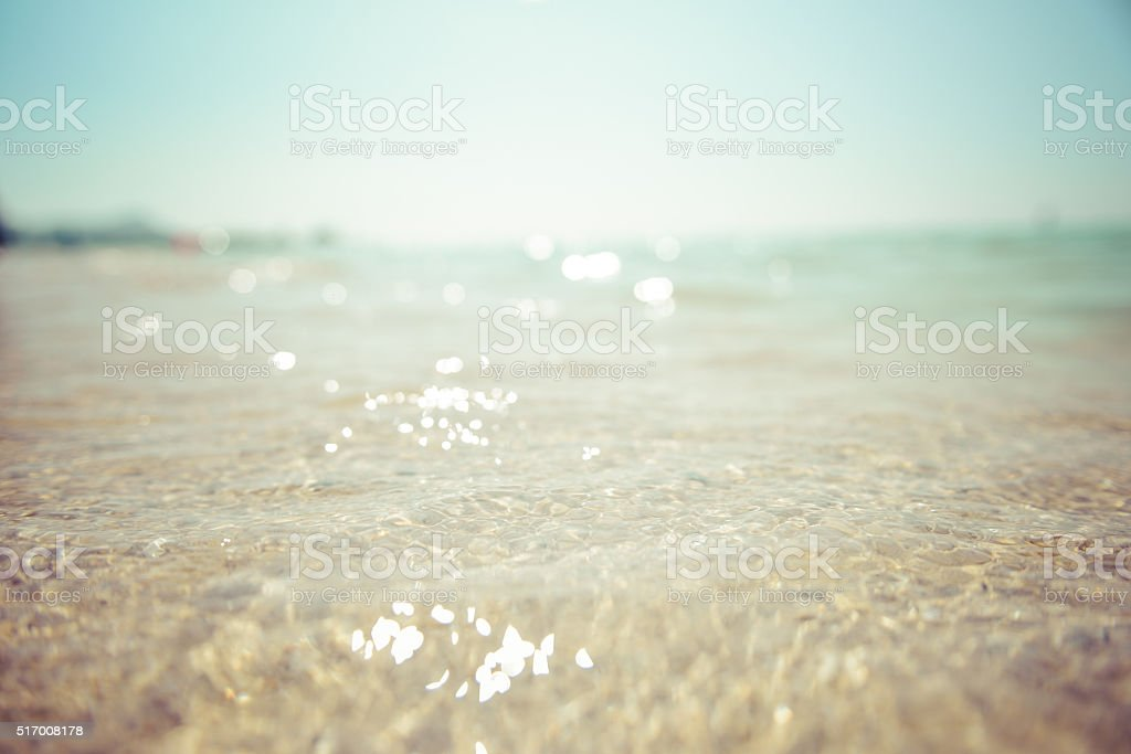 Sand and waves stock photo