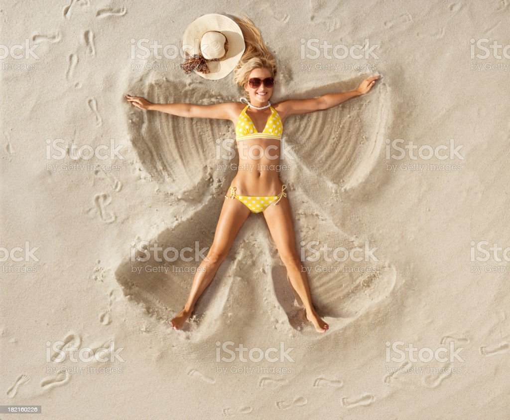 Sand Angel in Polka dot bikini stock photo