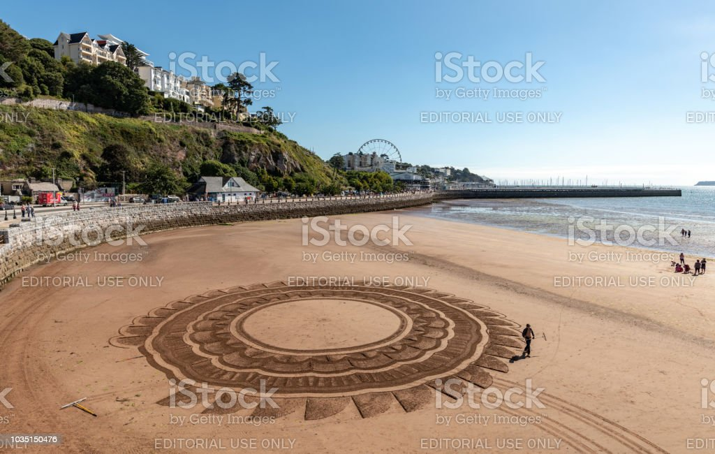 Sand art on the beach in Torquay, Devon stock photo
