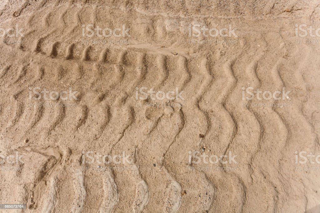 sand background with tire track royalty-free stock photo