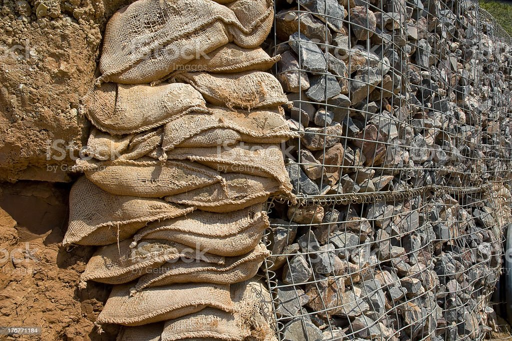 Sand bags and rock walls royalty-free stock photo