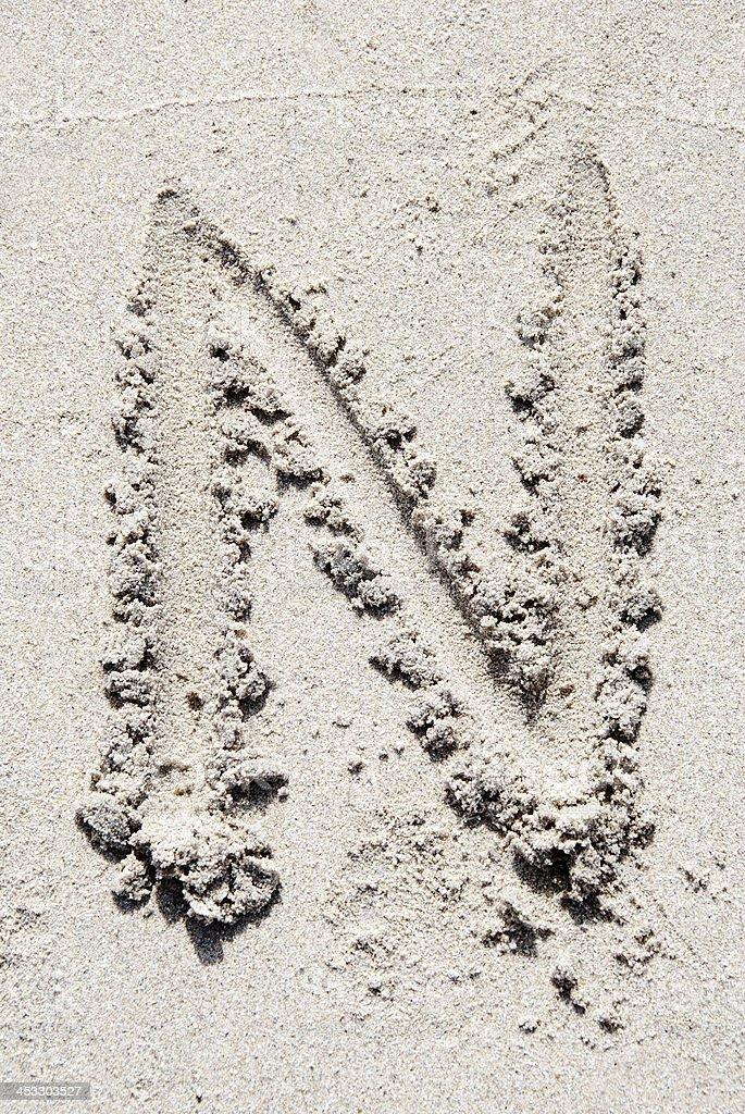 Sand beach alphabet: letter N stock photo