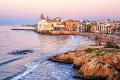 Sand beach and historical Old Town in mediterranean resort Sitges near Barcelona, Costa Dorada, Catalonia, Spain