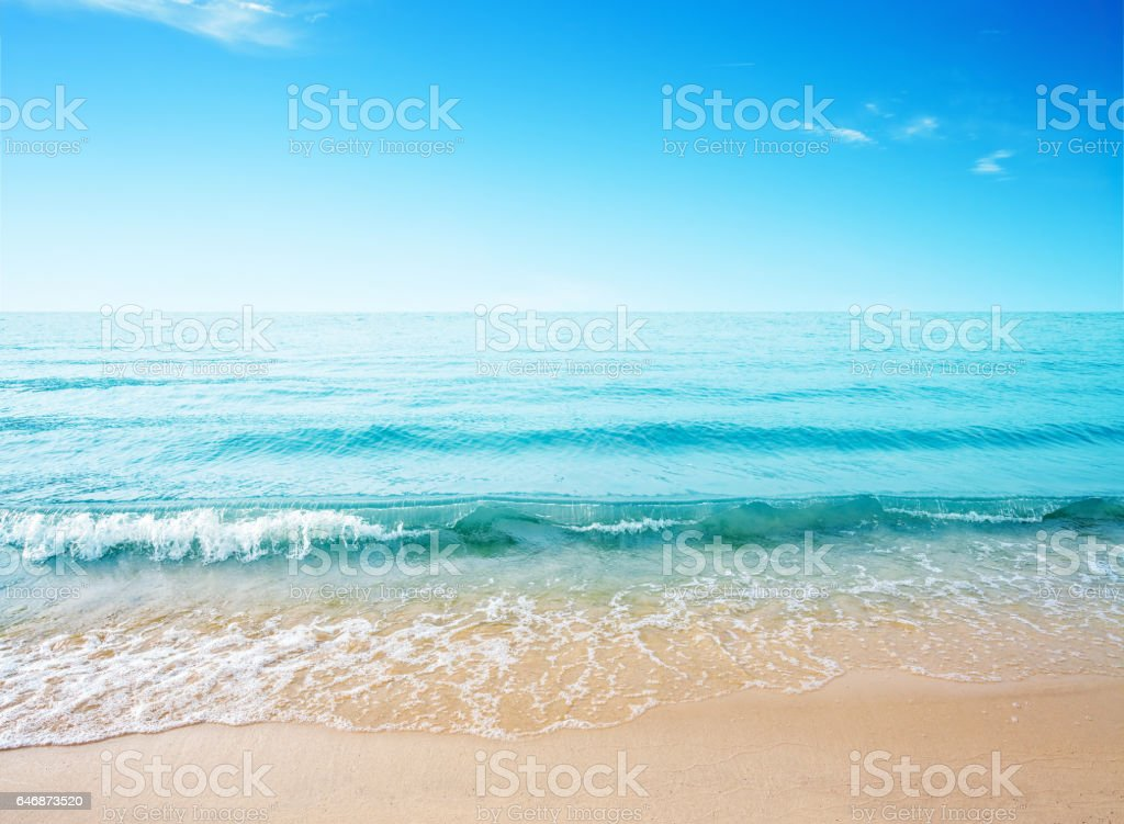 Sand beach and sea wave stock photo