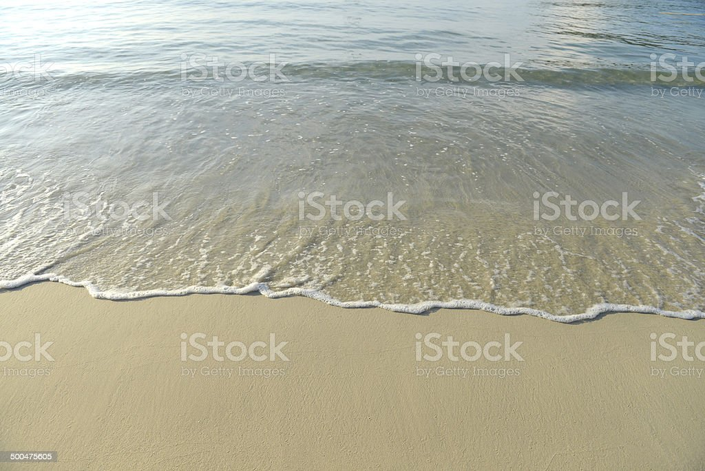 Sand beach and wave stock photo